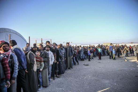 Эрдоган пригрозил открыть двери для беженцев в Европу